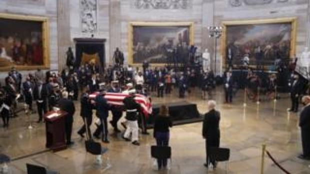 The casket of US Representative from Georgia John Lewis arrives during a ceremony preceding the lying in state in the Rotunda of the US Capitol in Washington, DC