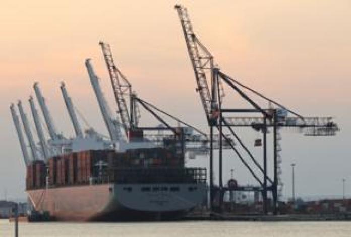 A lot container ship docking at port