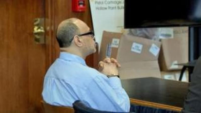 Harrison watches during Friday's sentencing hearing