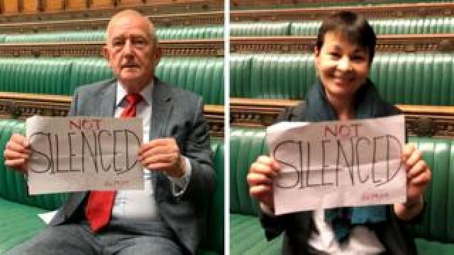 Barry Sheerman MP and Caroline Lucas MP hold signs