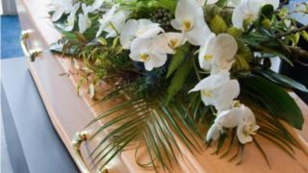flowers on coffin