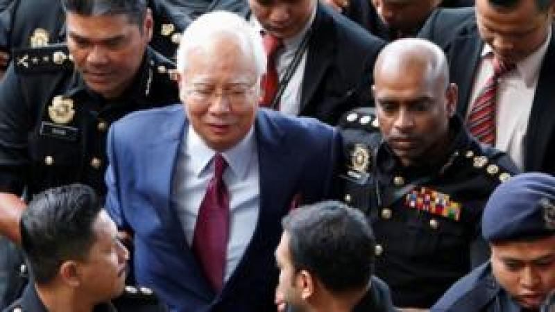 Mr Najib arriving in court on 4 July
