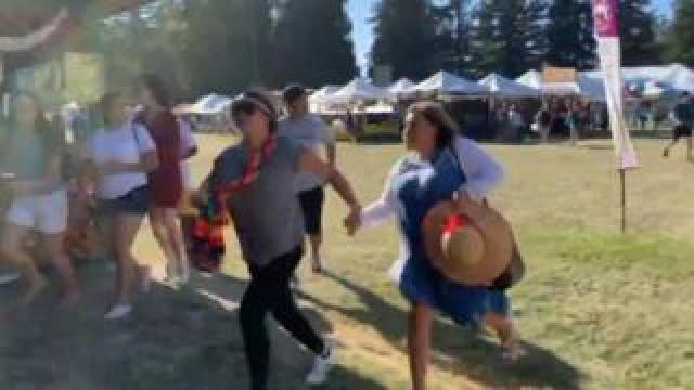 People run at the Gilroy Garlic Festival, 28 July 2019