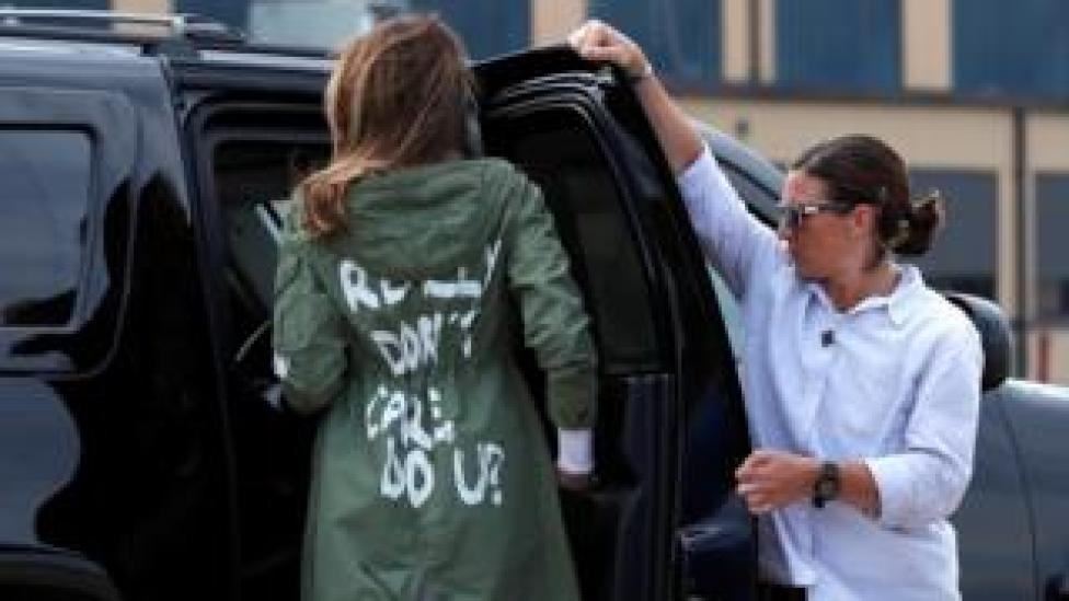 """US First Lady Melania Trump walks from her to airplane to her motorcade wearing a Zara design jacket with the phrase (slogan) """"I Really Don""""t Care. Do U?"""" on the back"""