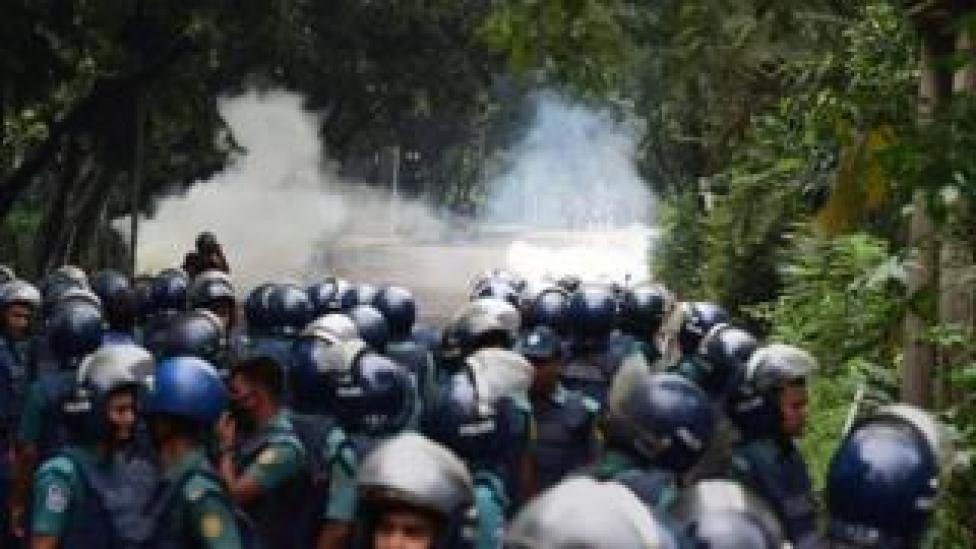 Bangladeshi police fire tear gas shell during clashes with students during a protest in Dhaka on August 5