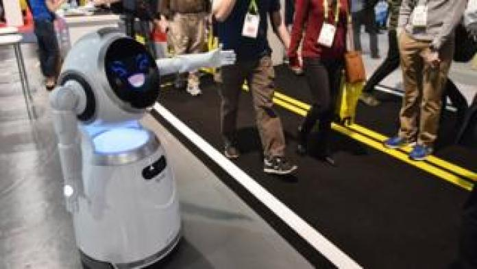 Cruzr service robot greets exhibition goers during CES 2018 at the Las Vegas Convention in Las Vegas on January 12, 2018.