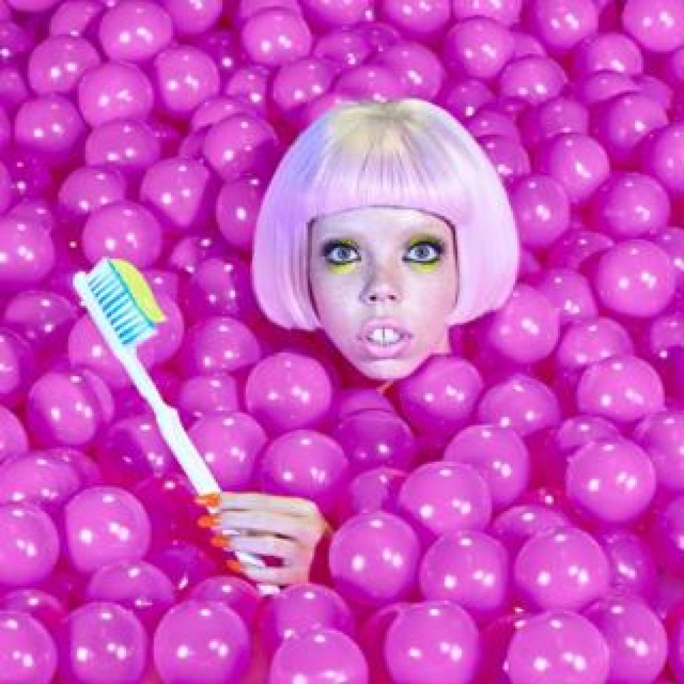 A woman in a pit of brightly coloured plastic balls.