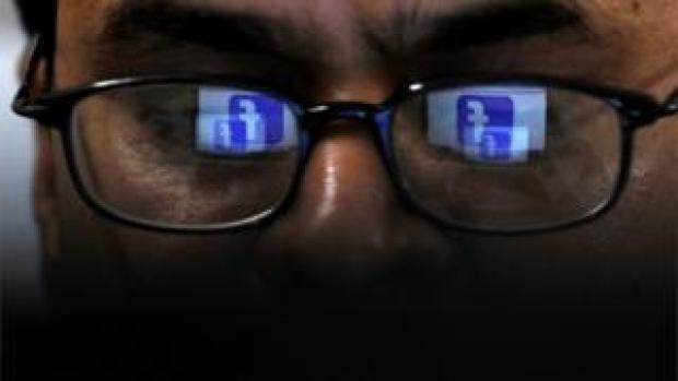 Man looking at Facebook