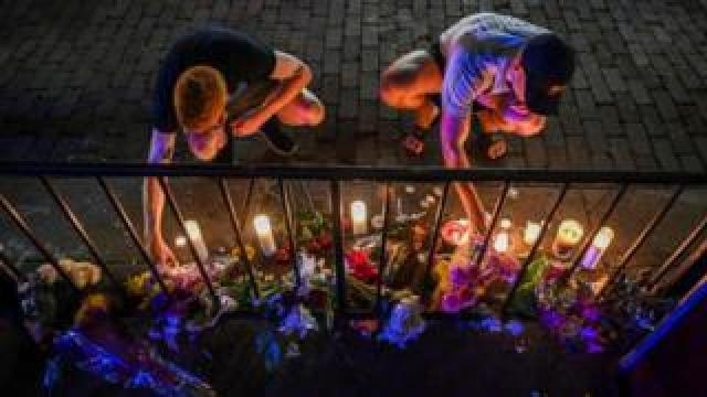 A makeshift memorial at the scene of Dayton, Ohio's mass shooting in August