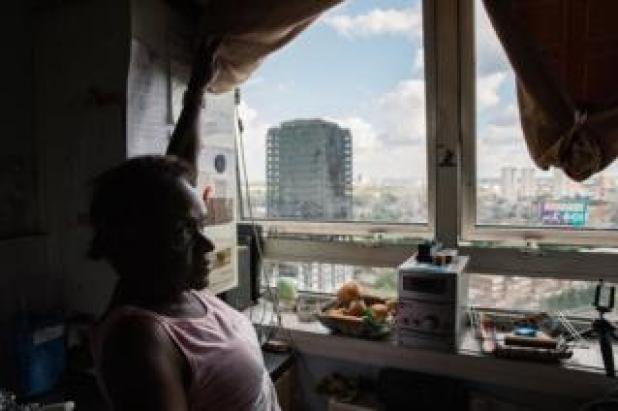Florence in her flat opposite Grenfell Tower