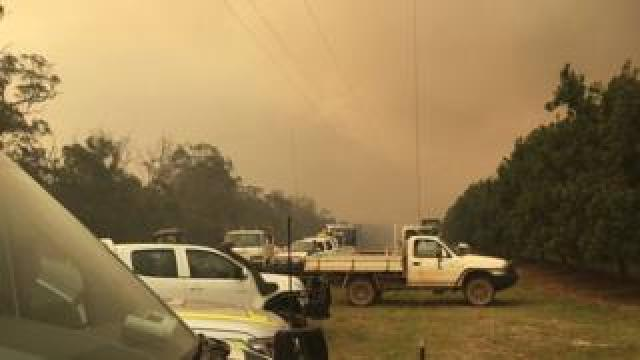 View of ambulance vehicles near a blaze in central Queensland