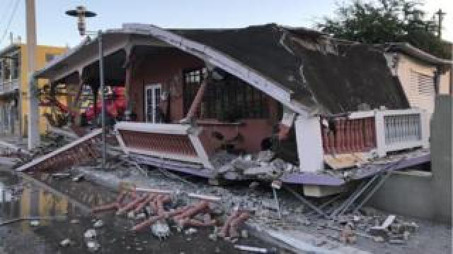 A home is seen collapsed after an earthquake in Guanica