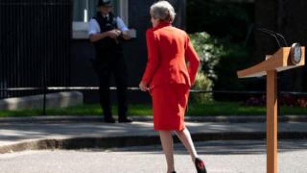 British Prime Minister Theresa May leaves after addressing the media to announce her resignation, outside 10 Downing Street, London, 24 May 2019