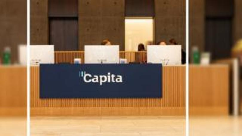 People working at the reception of Capita's offices
