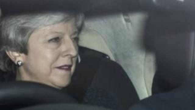 Theresa May arriving at Parliament