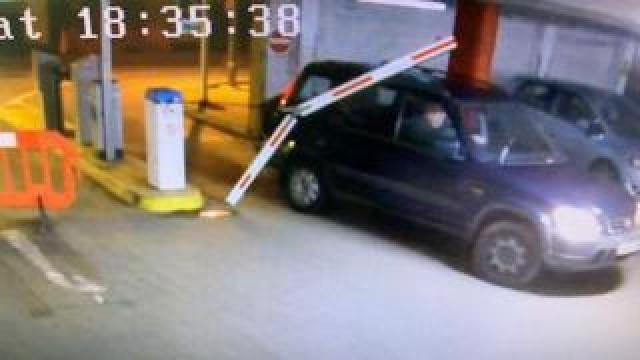 A car driving through a barrier