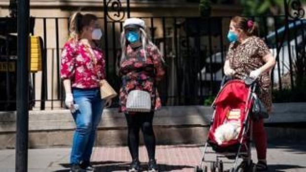 People wearing face masks in London