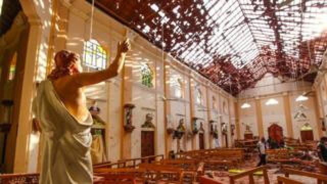 Officials inspect the damaged St. Sebastian's Church after multiple explosions targeting churches and hotels across Sri Lanka on April 21, 2019 in Negombo, north of Colombo, Sri Lanka.