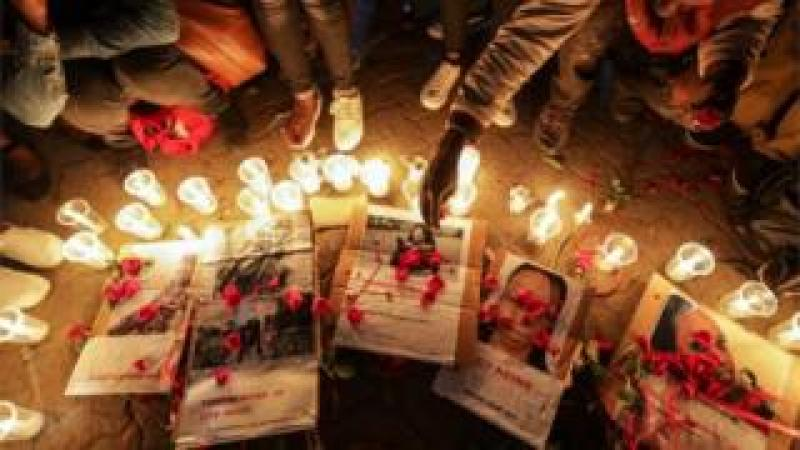 Kenyan activists light candles during a night vigil for the murdered university student Sharon Otieno, who was seven-month pregnant at the time of her death, as part of a protest to demand justice for her and other female university students who have been murdered in similar ways in Nairobi, Kenya, 14 September 2018