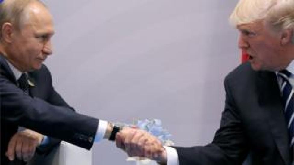 trump President Putin and President Trump, shaking hands at the G20 summit in Hamburg, Germany in 2017