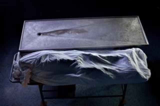Wrapped body in a morgue. Part of 'Crossfire', a photo story by Shahidul Alam. November 20, 2009.