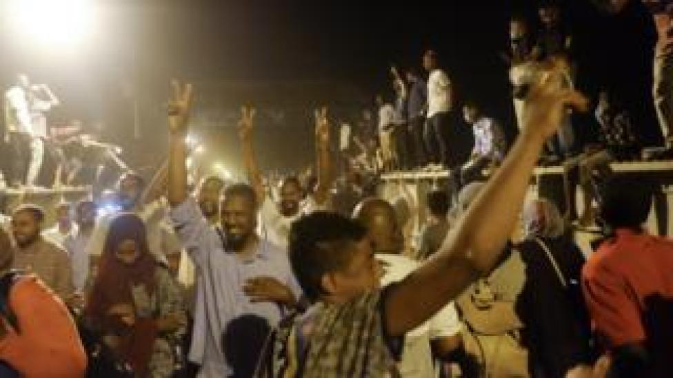 Crowds crossing a bridge to go to a sit-in at the military HQ in Khartoum, Sudan - Monday 8 April 2019