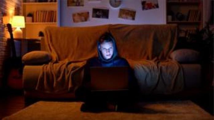 Teen boy on laptop
