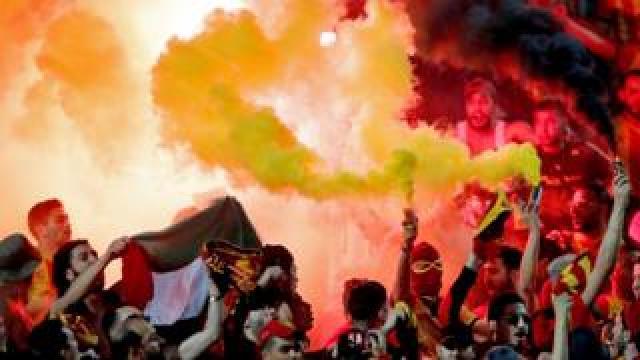 Esperance football fans holding flares at the al-Ahly Stadium in Cairo, Egypt - Friday 28 February 2020