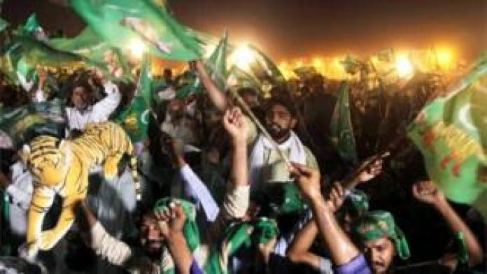 Pakistan Muslim League-Nawaz (PML-N), during a pre-election campaign in Multan on July 22, 2018 slogans and wave flags.