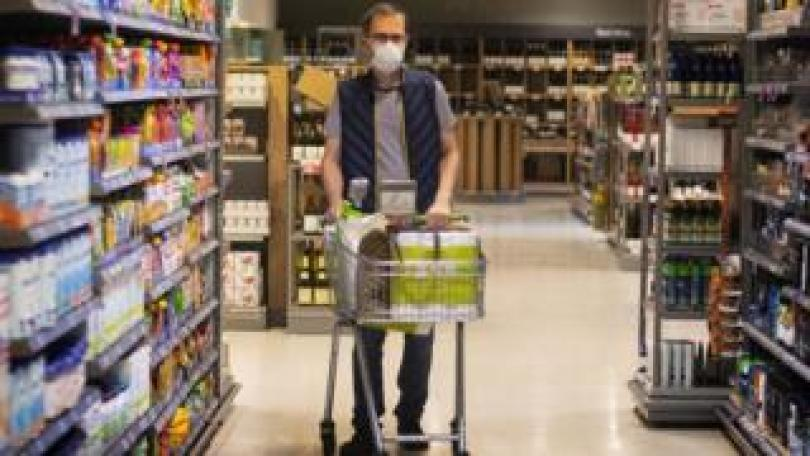 A man wearing a face mask in a supermarket in east London