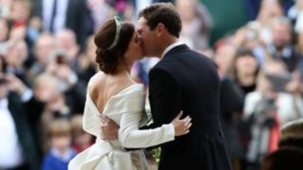 Princess Eugenie and Jack Brooksbank kiss outside St George's chapel