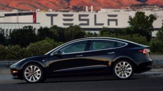 The first production model of the Tesla Model 3 out the assembly line in Fremont, California , U.S. is seen in this photo from July 10, 2017.