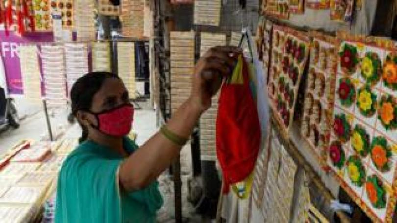 Woman sellign face masks in India