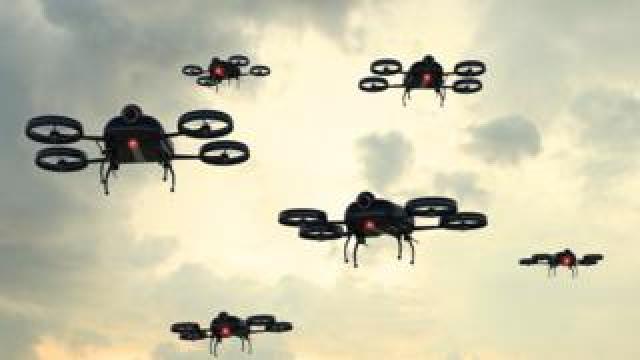 A swarm of quadcopter drones