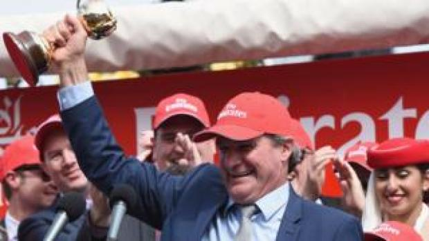 Darren Weir holding the Melbourne Cup trophy after his win in 2015