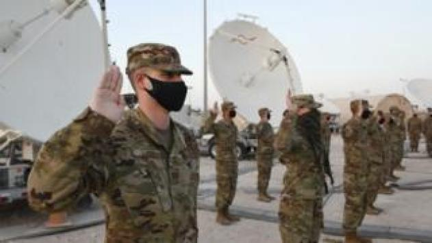 Troops take the oath in Qatar earlier this month