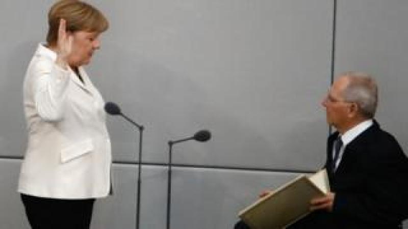 Angela Merkel takes the oath with Bundestag president Wolfgang Schaeuble