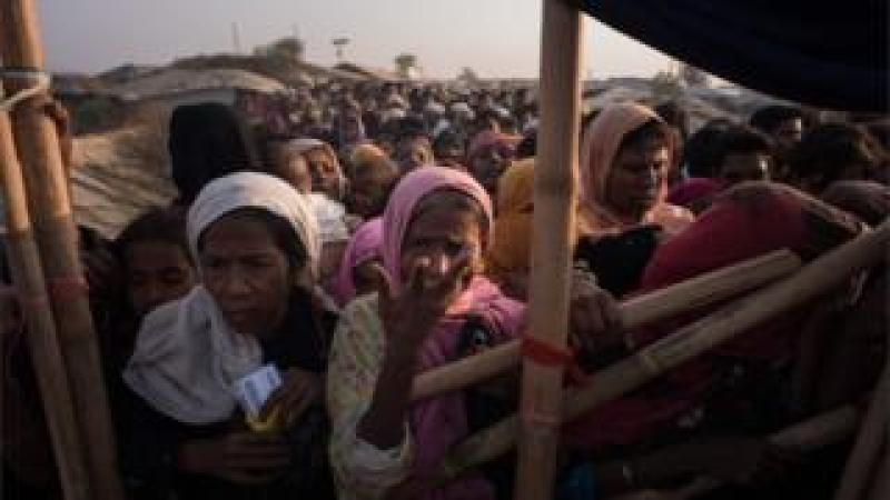 Rohingya women queue at a relief centre at the Kutupalong refugee camp in Cox's Bazar.