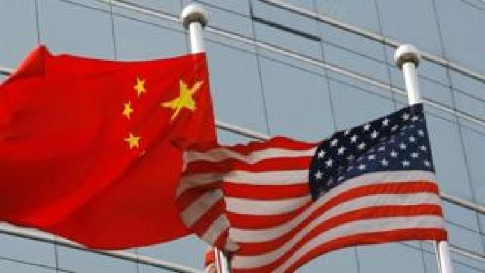 Flags of China (left) and the US. File photo