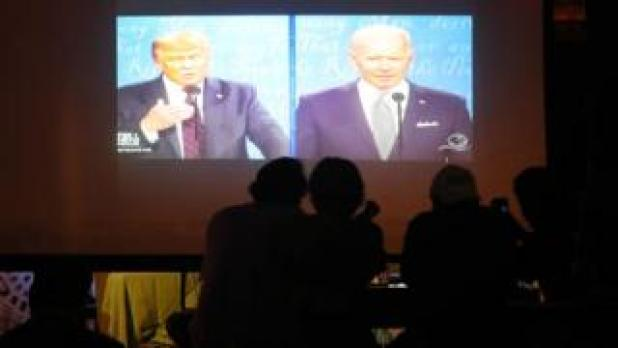 People in the Miami Bar watch Donald Trump and JB Biden take part in the debate over their first presidential election campaign in 2020.