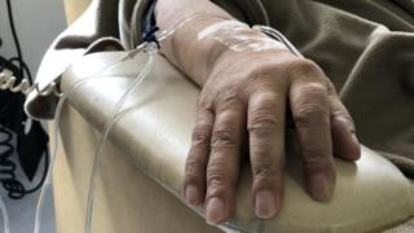 A female patient receives chemotherapy treatment for cancer