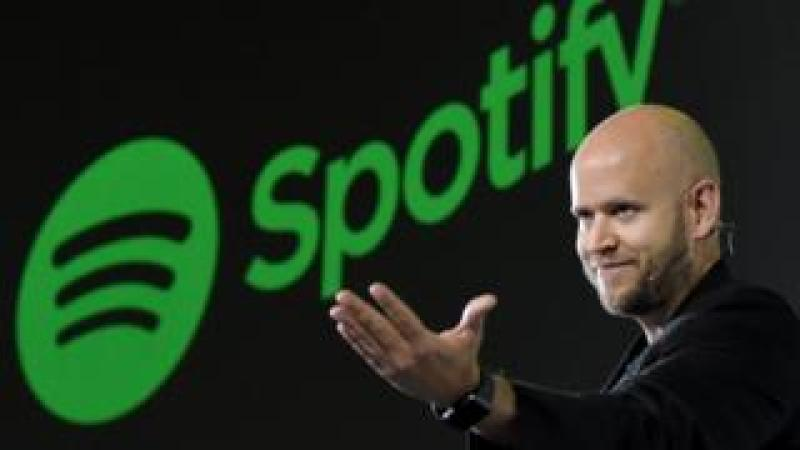 Daniel Ek, CEO of Swedish music streaming service Spotify, gestures as he makes a speech at a press conference in Tokyo on September 29, 2016.