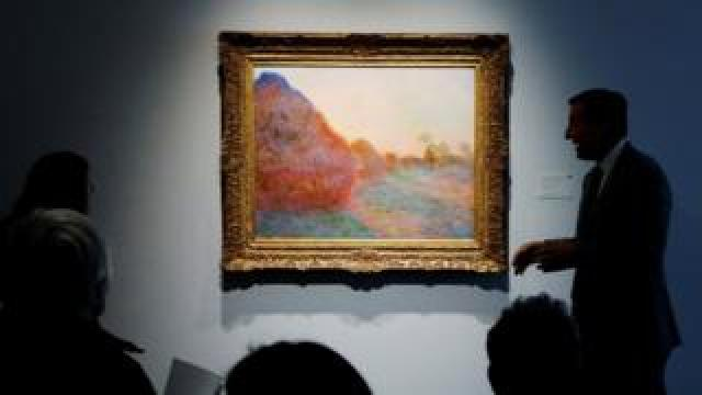A painting by Claude Monet - one of his Haystacks series - on display in New York ahead of its auction