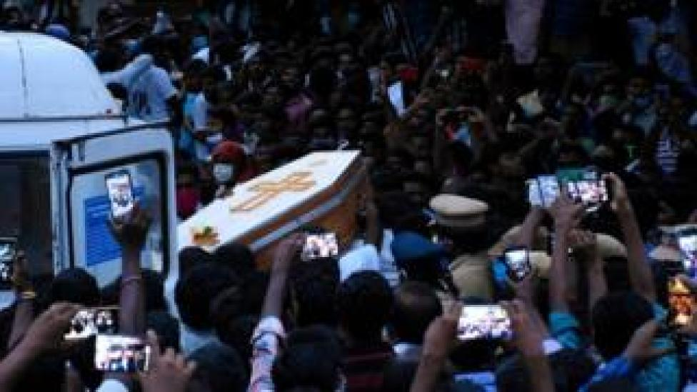 Residents gather as they carry the coffin of Jeyaraj, 58, and son Fenix Immanuel, 31, allegedly tortured at the hands of police in Sathankulam, Thoothukudi district in the Indian state of Tamil Nadu.