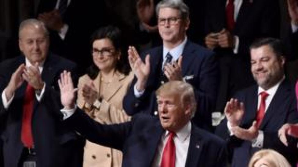 trump Donald Trump is greeted warmly at the Economic Club of New York