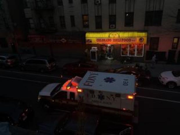 Ambulance outside Ana's apartment