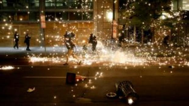 People run as police disperse demonstrators during a protest amid nationwide unrest following the death in Minneapolis police custody of George Floyd, in Washington, 31 May 2020