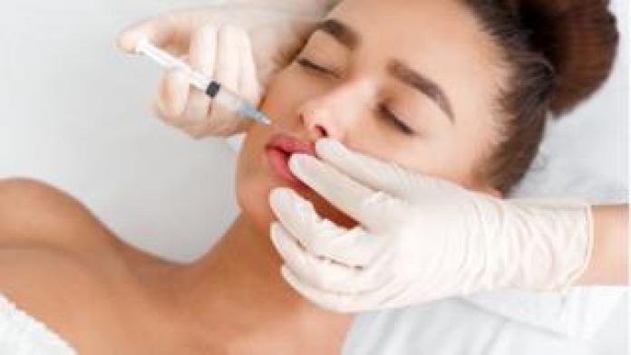 Woman having a lip filler