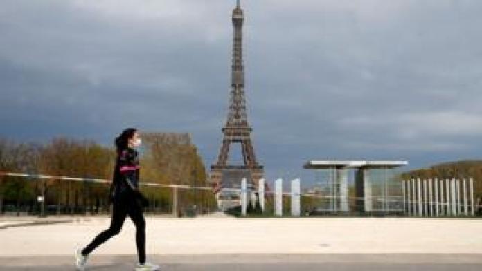 Jogger near the Eiffel Tower, Paris
