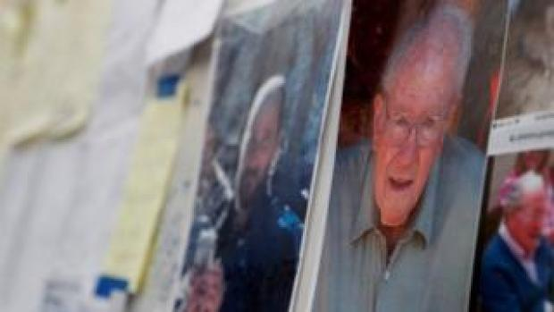 Missing photographs posted at evacuation centre in Chico
